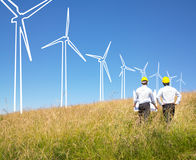 Engineers building windmills Stock Image