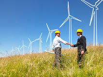 Engineers building windmills Stock Photo