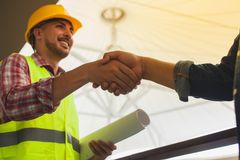 Engineers celebrating success, clapping with hands.Teamwork conc Stock Photo