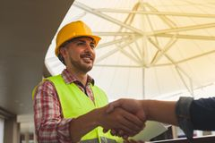 Engineers celebrating success, clapping with hands.Teamwork conc royalty free stock photos