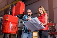 Engineers checking installation of new CNC plasmas machine Royalty Free Stock Image