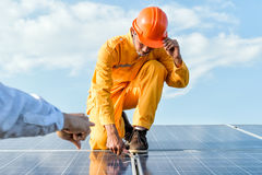 Engineers checking solar panels, Solar Energy . Royalty Free Stock Photography