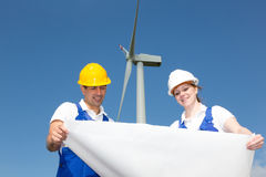 Engineers with construction plan in wind farm Stock Image