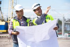 Engineers At Construction Site Stock Images