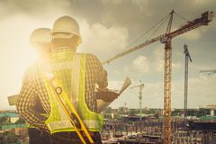 Engineers and construction sites. And crane royalty free stock photos