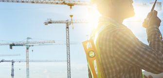 Engineers and construction sites. And crane stock photos