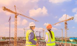 Engineers and construction sites. And crane stock photo