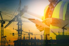 Engineers and construction sites. Double exposure royalty free stock photography