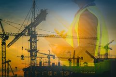 Engineers and construction sites. Double exposure royalty free stock image