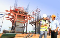 Engineers and construction sites. And crane royalty free stock photography