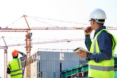 Engineers and construction sites. And crane stock photography
