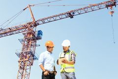 Engineers and construction sites. And crane royalty free stock photo