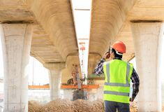 Engineers. Engineers and construction sites roads royalty free stock image
