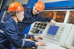 Engineers at control panel Stock Photos