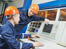 Engineers at control panel Stock Photo