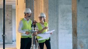 Engineers discuss a project, standing on a site, close up. stock footage