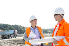 Engineers discussing at construction site against clear sky Stock Photography