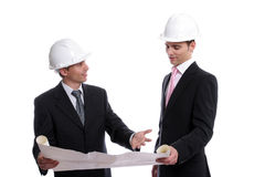 Engineers discussing new project. Isolated in white background royalty free stock photo