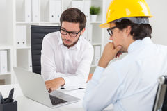 Engineers discussing park project Stock Images