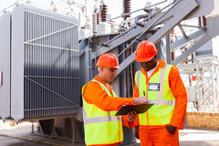 Engineers discussing work. Electrical engineers discussing work in power plant Royalty Free Stock Photo