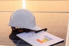 Engineers are examining the performance graph of energy production from solar panels that are alternative energy and which is the. Concept of sustainable royalty free stock image