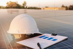 Engineers are examining the performance graph of energy production from solar panels that are alternative energy and which is the. Concept of sustainable royalty free stock images