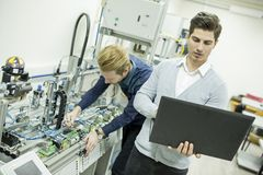 Engineers in the factory Stock Photography