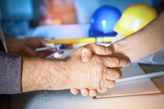 Construction engineers handshake. Stock Photos