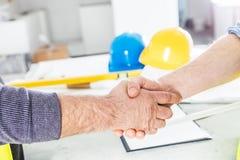 Construction engineers handshake. Stock Photo