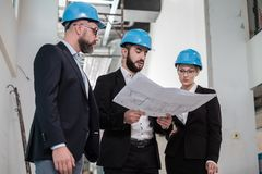 Engineers in hardhats have conversation Royalty Free Stock Photography