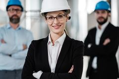 Engineers in hardhats have conversation stock images
