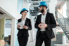 Engineers in hardhats have conversation royalty free stock photos