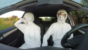 Engineers in hazmat suits driving to their rescue mission -. Engineers in hazmat suits driving to their rescue mission stock video footage