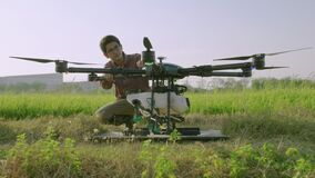 Engineers are inspecting Agricultural drones are taking off to spray medicine or fertilizers into the rice fields.