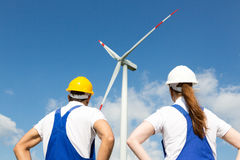 Engineers or installers posing in front of wind energy turbine Stock Image
