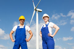 Engineers or installers posing in front of wind energy turbine Royalty Free Stock Photo