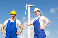 Engineers or installers posing in front of wind energy turbine Royalty Free Stock Images