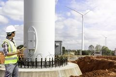Engineers wind turbine. Engineers are investigating the wind turbine royalty free stock photo
