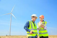 Wind turbine. Engineers are investigating the wind turbine stock photos