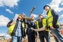 Engineers and investor meeting at the construction site. Royalty Free Stock Photo