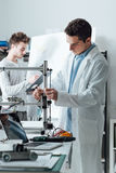 Engineers in the lab using a 3D printer Royalty Free Stock Photo