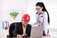 Engineers with laptop in the office Royalty Free Stock Image