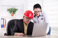 Engineers with laptop in the office Royalty Free Stock Photos