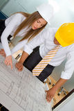 Engineers looking at blueprints Royalty Free Stock Photo