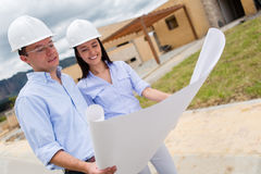 Engineers looking at blueprints Stock Photo