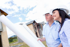 Engineers looking at house project Stock Image