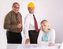 Engineers at the meeting. A tem of three engineers of different age at the meeting royalty free stock image