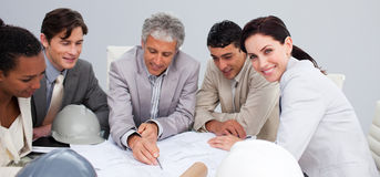Engineers in a meeting studying plans Stock Photography