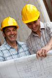 Engineers with a model Royalty Free Stock Photos