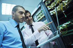 It engineers in network server room stock images